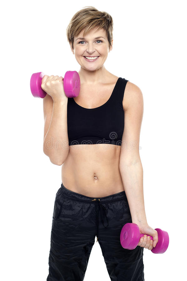 Cheerful middle-aged woman woman working out royalty free stock photo