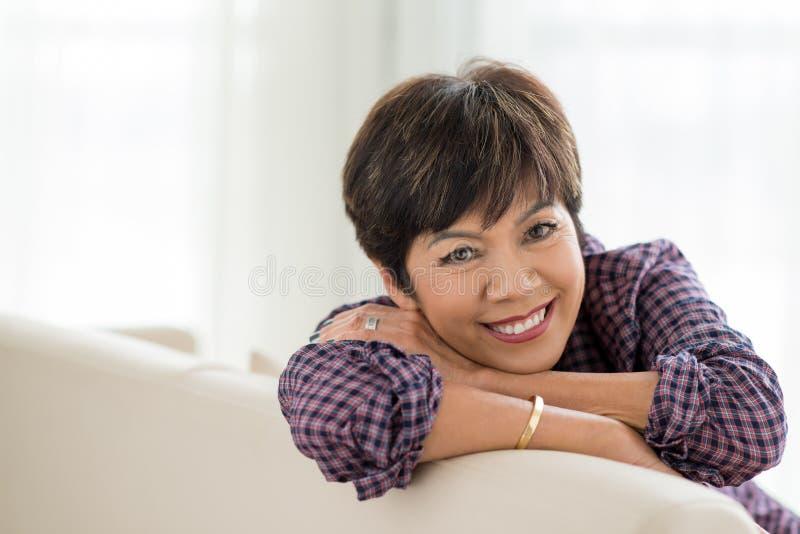Cheerful mixed-race senior woman. Portrait of cheerful mixed-race senior woman at home stock images