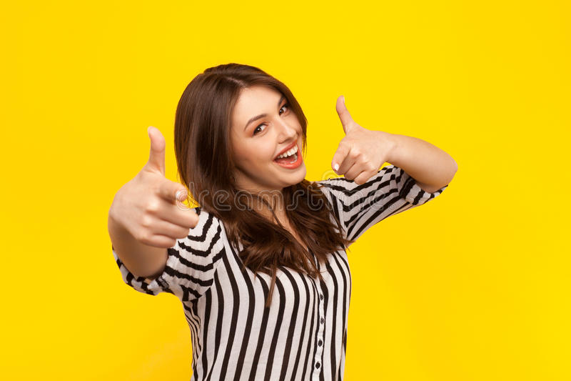 Cheerful model showing thumbs up stock photos