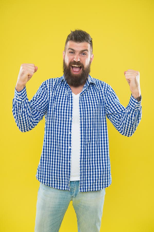 Cheerful mood. Beard fashion and barber concept. Man bearded hipster stylish beard yellow background. Barber tips. Maintain beard. Beard and mustache care royalty free stock image