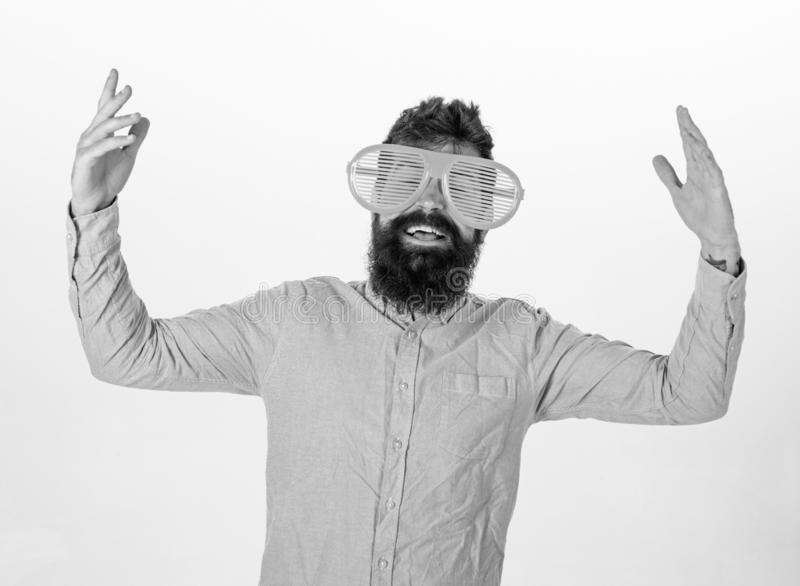 Cheerful mood concept. Hipster looking through of giant striped sunglasses. Guy with beard having fun. Man with beard. And mustache on happy face wears funny stock images