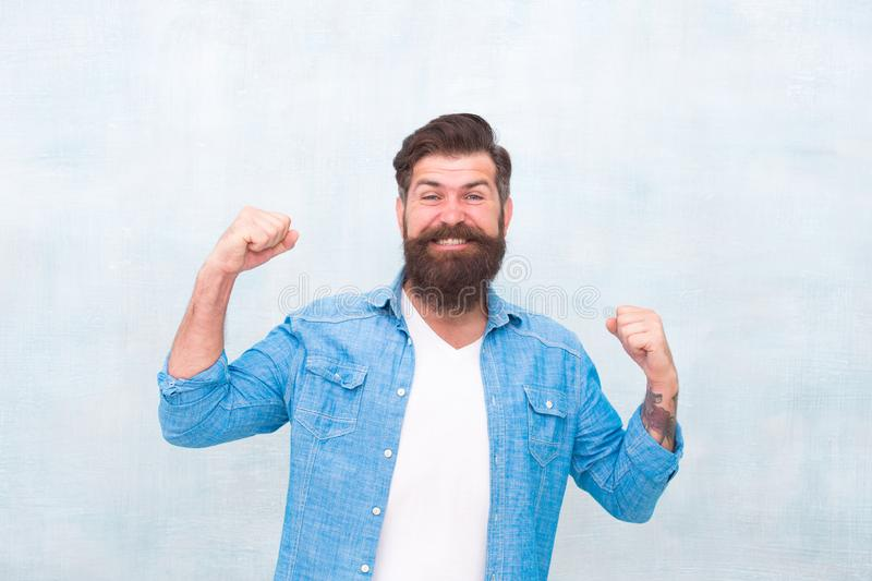Cheerful mood. Happiness and joy. Hipster with beard and mustache happy expression. Celebration concept. Brutal handsome. Hipster man on grey wall background royalty free stock photos