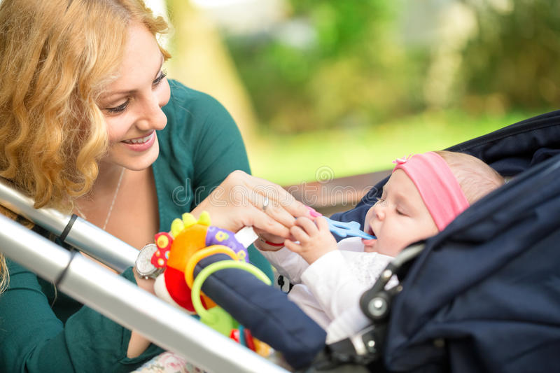 Cheerful mother with her baby stock photography