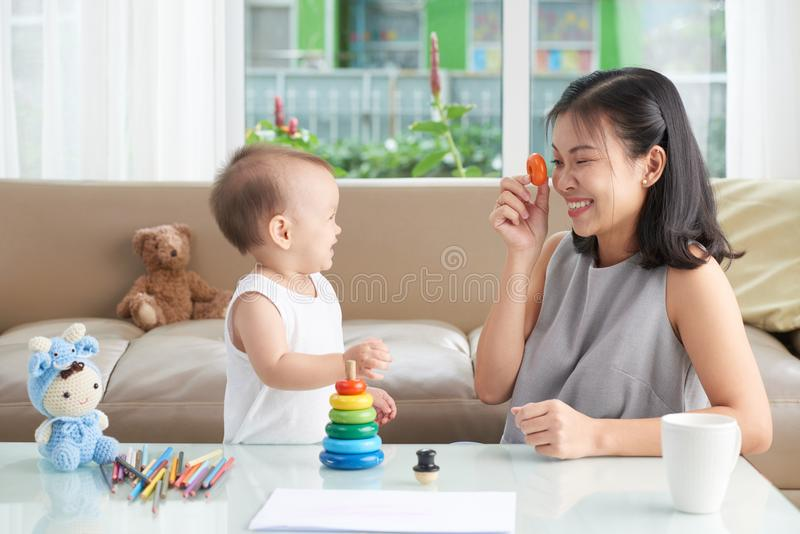 Mother playing with daughter stock image