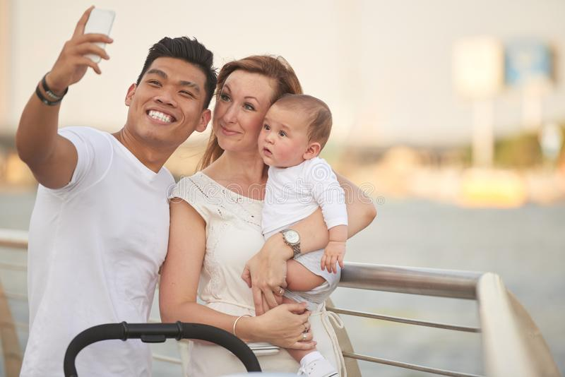 Happy multi-ethnic family stock photos