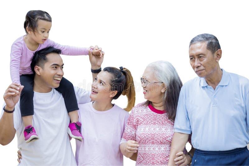 Cheerful multi generation family chatting on studio stock image