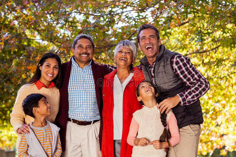 Cheerful multi-generation family laughing at park stock photos