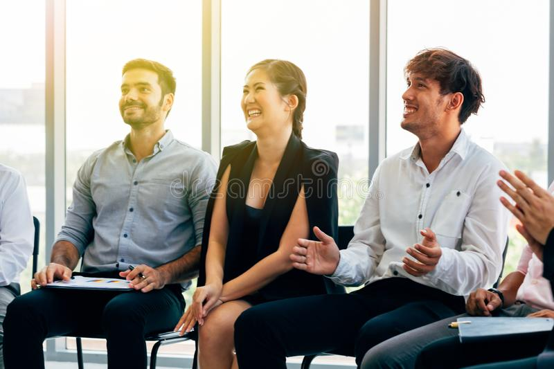 Cheerful multiracial colleagues on conference stock photos