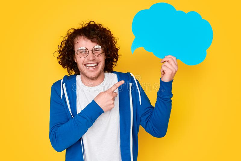 Cheerful nerdy guy pointing at thought bubble royalty free stock image