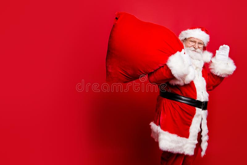 Cheerful nice peaceful Santa in eyeglasses wishes you merry Chri royalty free stock photos