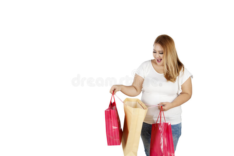 Cheerful obese woman holds shopping bags stock images