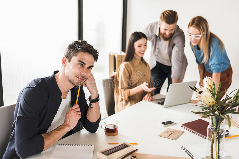 Cheerful office team working together stock photography
