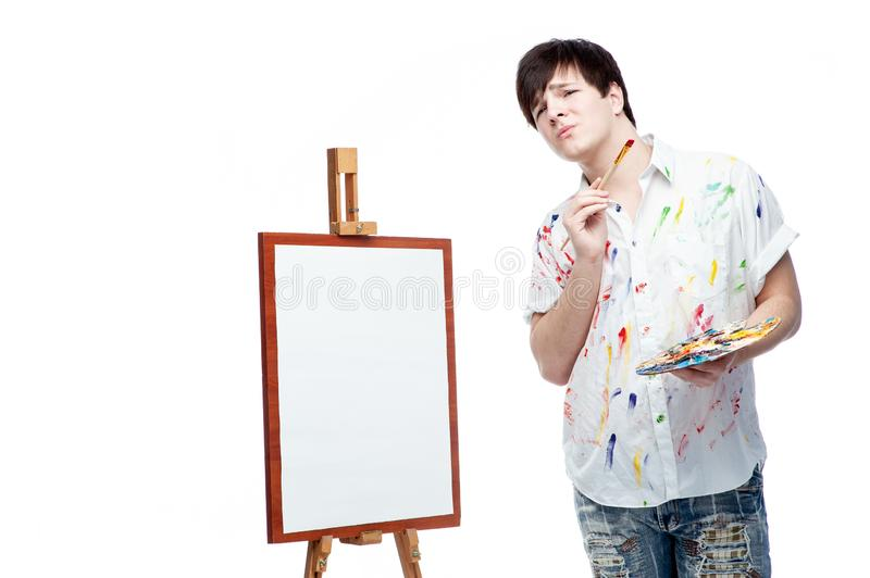 Cheerful painter with brush and palette stock photo