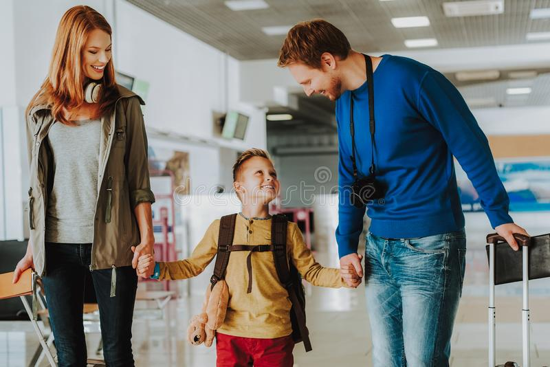 Cheerful parents with son are looking forward to trip royalty free stock photography
