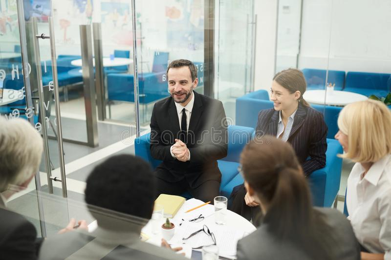 Cheerful People in Business Meeting royalty free stock photography