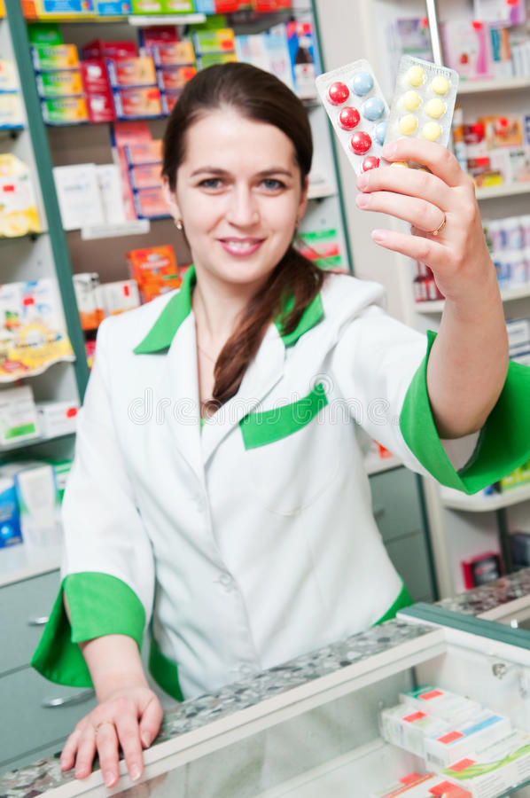 Cheerful Pharmacist Chemist Woman Stock Photo