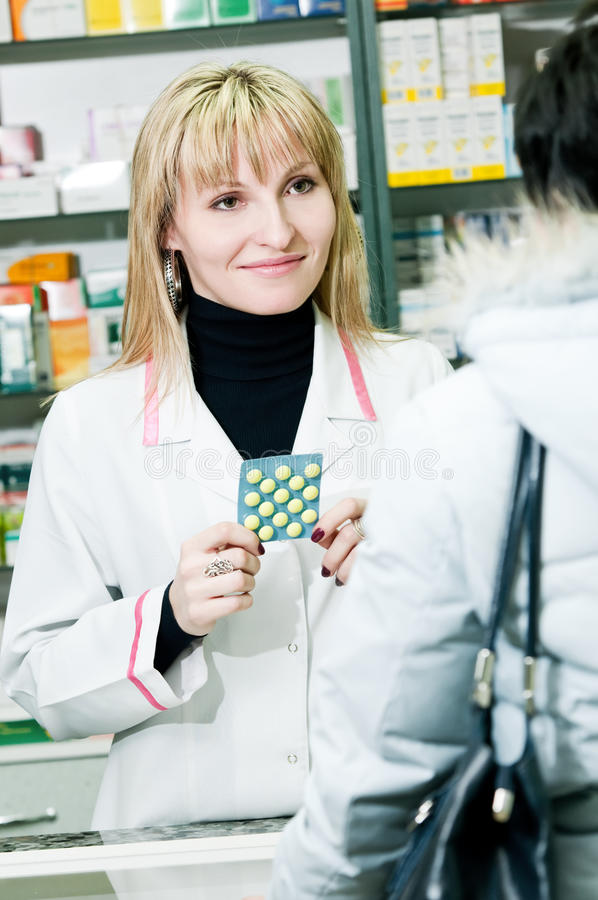 Download Cheerful Pharmacist And Client Stock Image - Image: 18945965