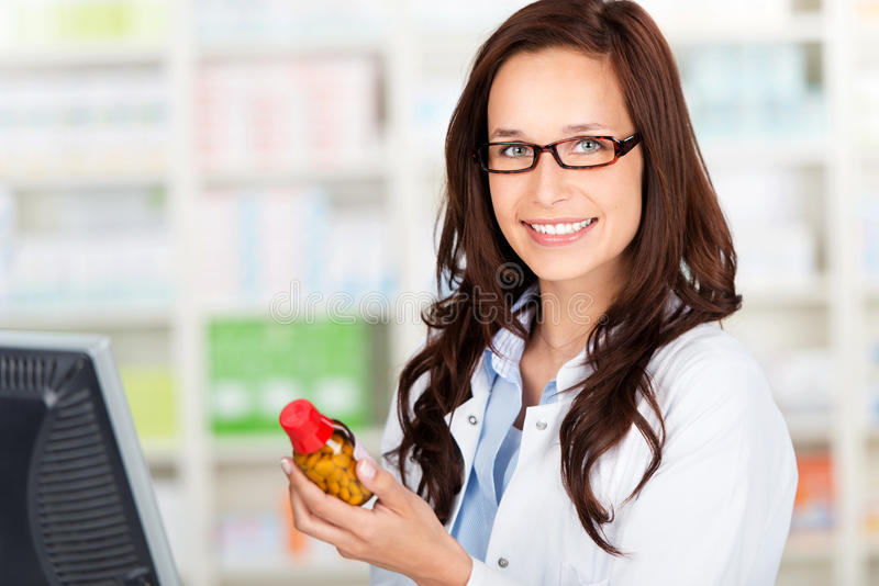 Cheerful pharmacist royalty free stock images