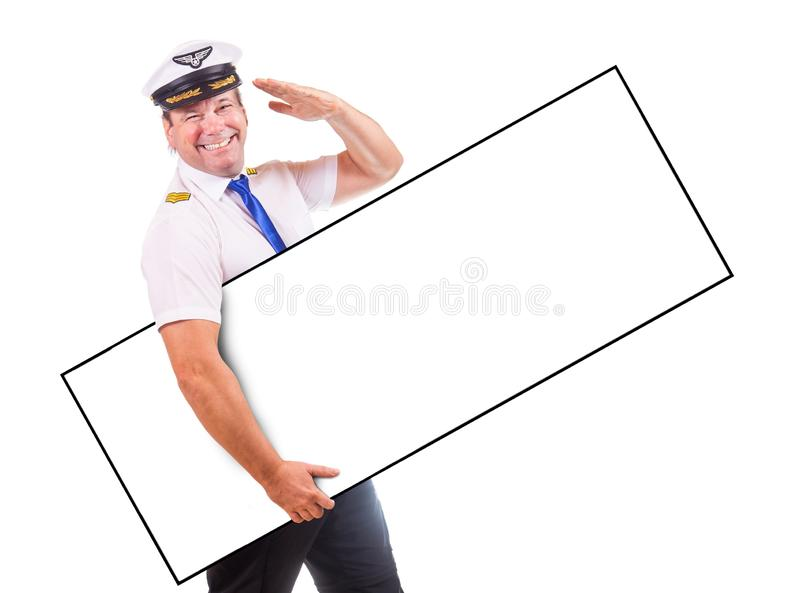 A cheerful pilot hold emty panel and salute royalty free stock photos