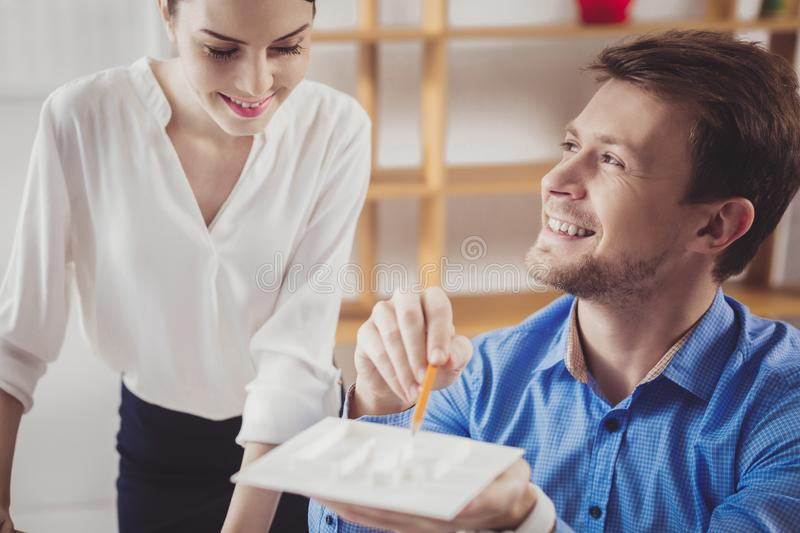 Cheerful positive man talking to his colleague royalty free stock photo