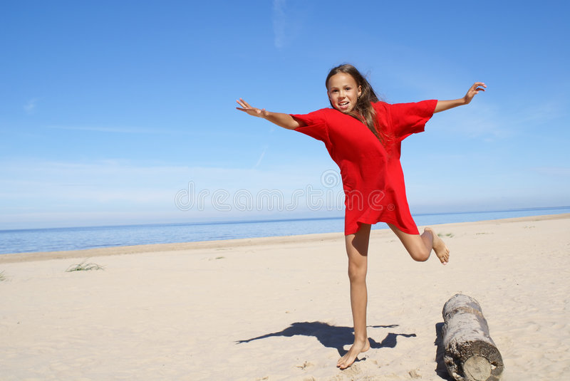 Cheerful preteen girl exercising royalty free stock photography