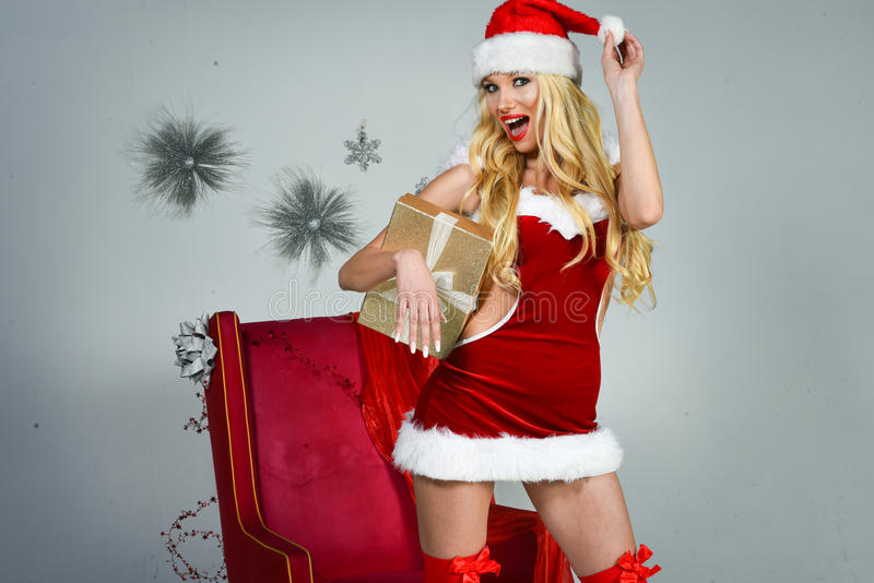 Cheerful pretty young woman in santa claus costume. royalty free stock photos