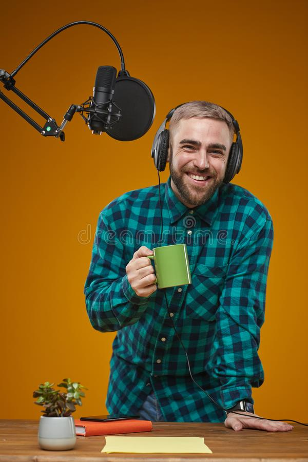 Cheerful Radio Presenter With Coffee royalty free stock photography