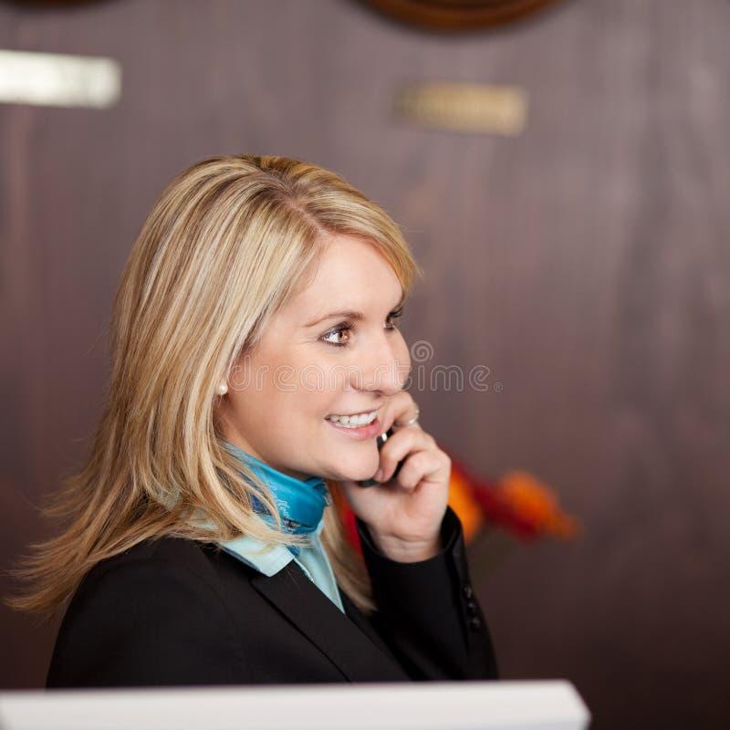 Free Cheerful Receptionist Using Telephone Stock Photos - 31352363