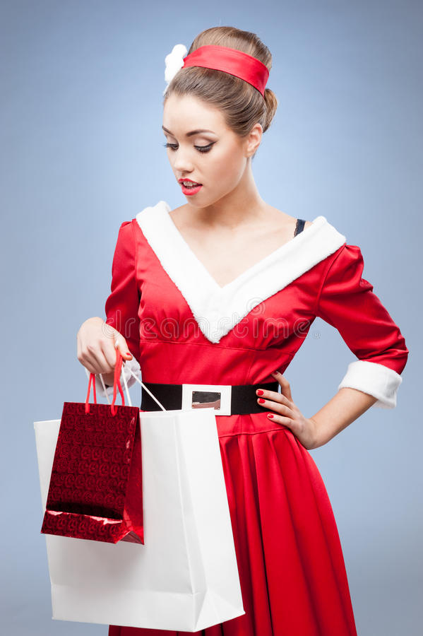Cheerful Retro Girl Holding Shopping Bags Royalty Free Stock Photography
