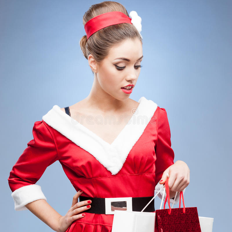 Download Cheerful Retro Girl Holding Shopping Bags Stock Image - Image: 43438479