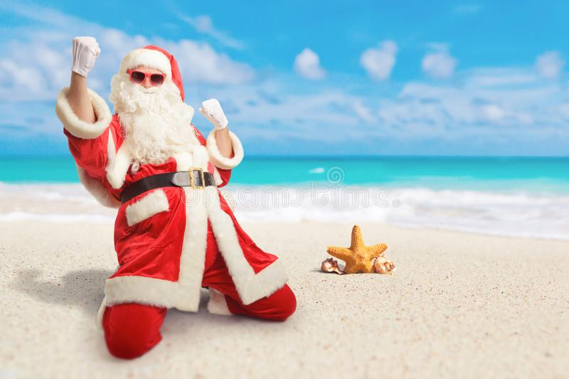 Cheerful Santa Claus is happy about his perfect vacation destin stock photo