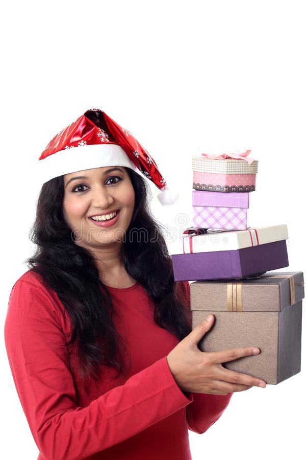 Cheerful Santa woman with gift boxes against white royalty free stock image