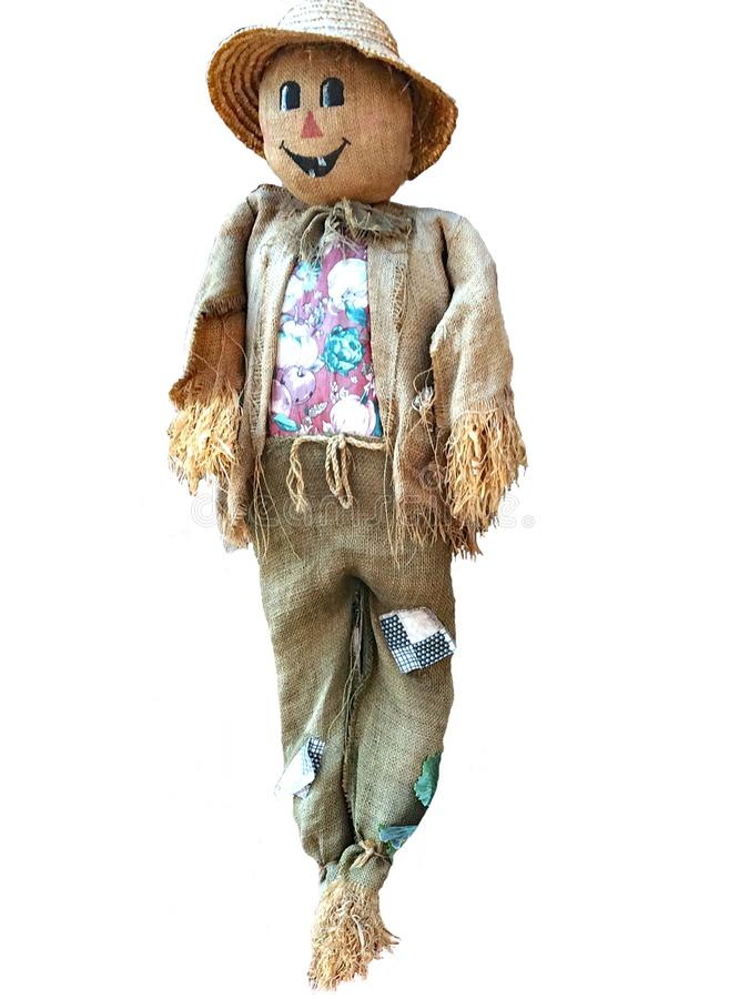 Cheerful Scarecrow Isolated on White. Friendly scarecrow clothed in patched burlap, a bright print shirt and straw hat and stuffed with straw. Pants held up with royalty free stock images
