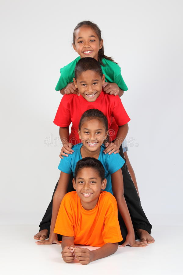Download Cheerful School Friends Form Human Totem-pole Stock Photo - Image: 16665322