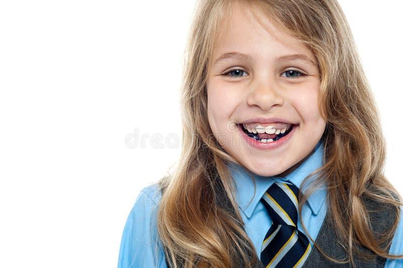 Cheerful school girl, closeup shot stock photography