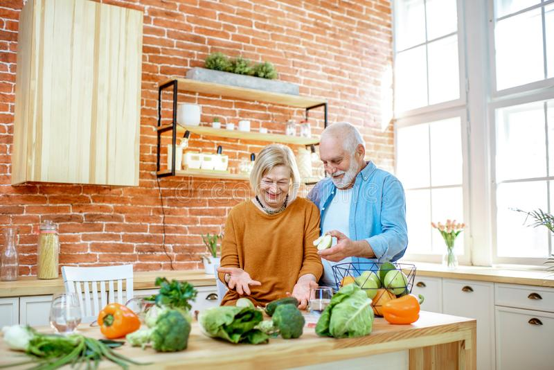 Senior couple with healthy food at home stock photos
