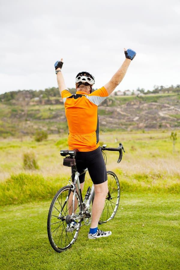 Cheerful senior cyclist royalty free stock image