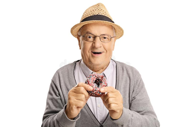 Cheerful senior man eating a donut. Isolated on white background stock photo