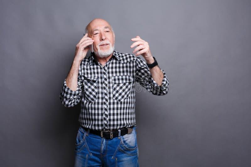 Cheerful senior man talking on phone stock images