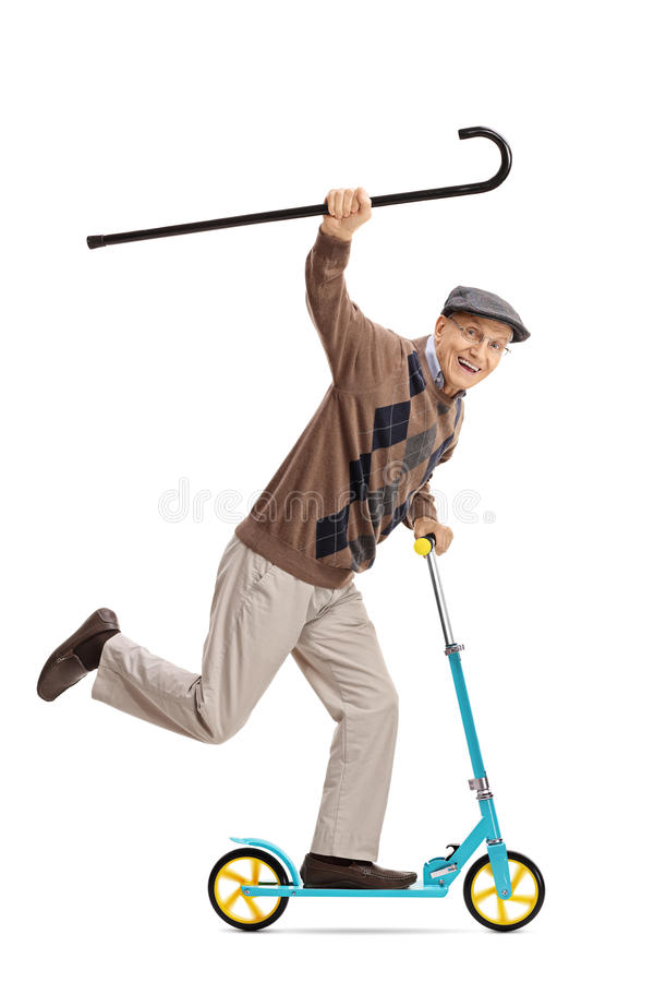 Cheerful senior riding a scooter and holding a walking cane. Full length portrait of a cheerful senior riding a scooter and holding a walking cane isolated on royalty free stock images