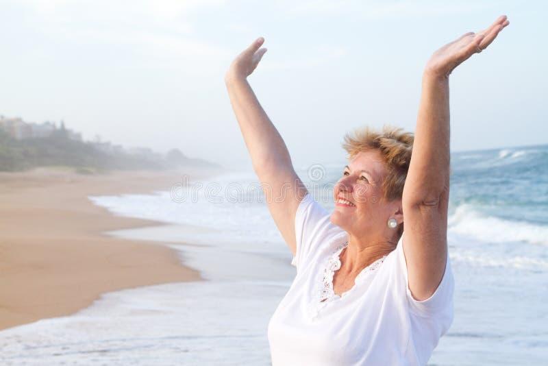 Cheerful senior woman stock image