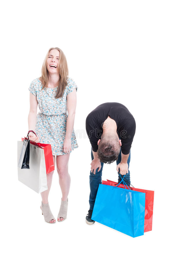 Cheerful shopper female laughing of tired boyfriend. Cheerful shopper female laughing of her tired boyfriend after a long day of shopping isolated on white with stock image