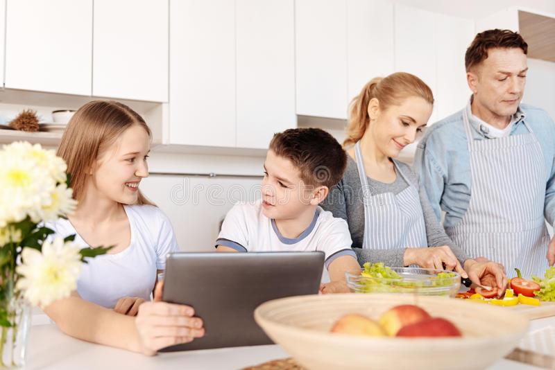 Cheerful siblings resting in the kitchen royalty free stock image