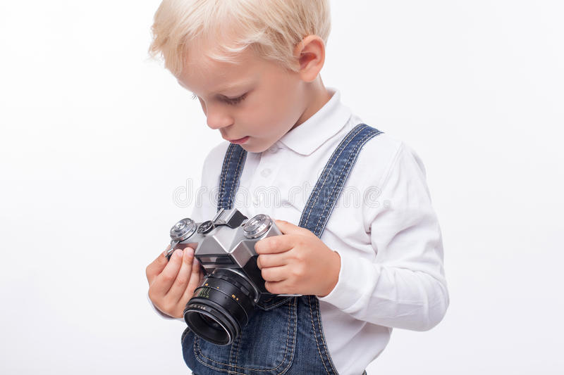 Cheerful small boy is preparing for making photos stock photos
