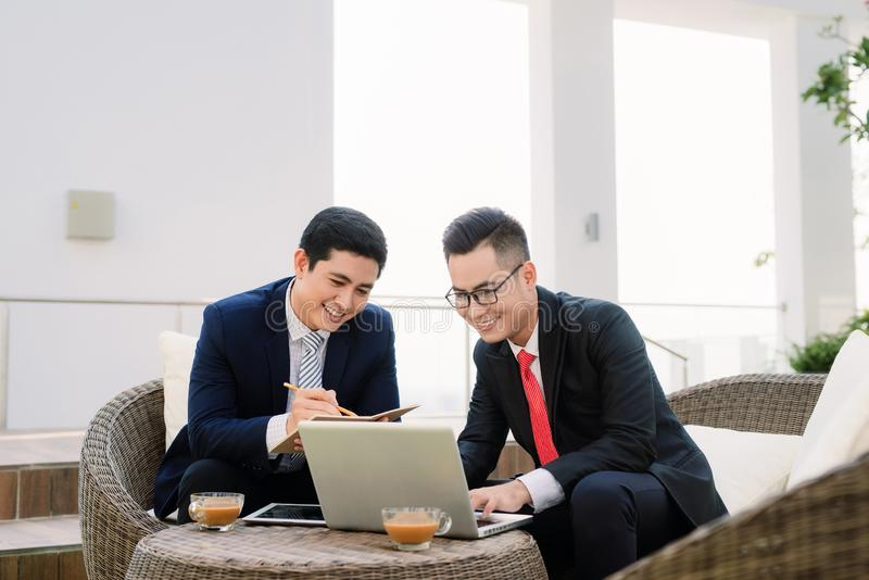 Cheerful smart businessmen discussing their project stock photos