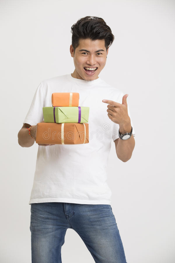 Download Cheerful Smart Indian Young Man Pointing With Gift Boxes Stock Image - Image of cheerful, pointing: 62510101