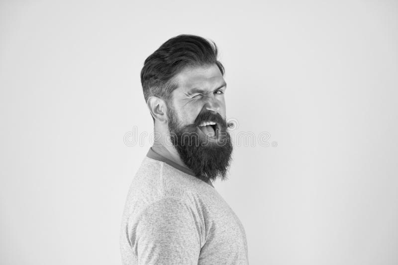 Cheerful smile. Man bearded hipster with mustache. Beard mustache grooming guide. Hipster handsome bearded guy yellow stock photo