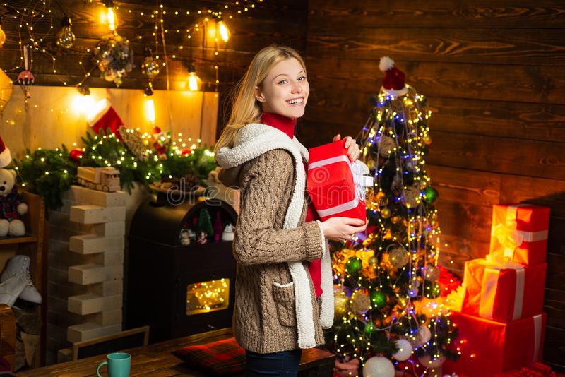 Cheerful smiling blonde girl holds New Year gift. Happy new year. Winter holidays and childhood concept. Portrait of stock images