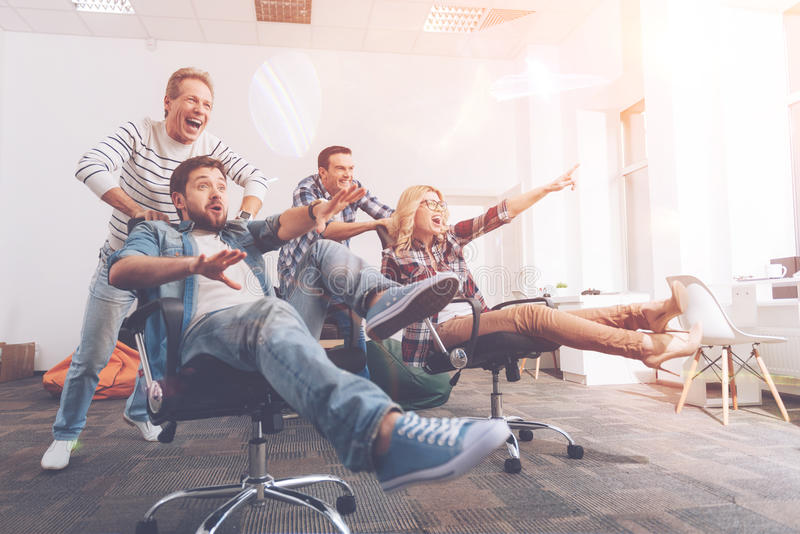 Cheerful smiling colleagues having rest in the office royalty free stock photo