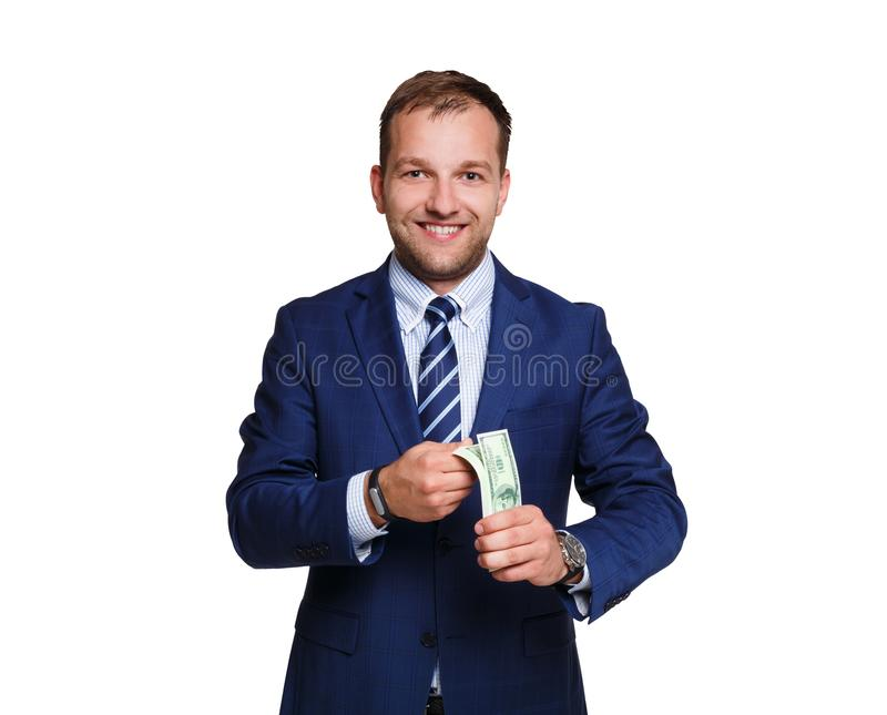 Smiling young businessman holding money isolated on white background stock photos